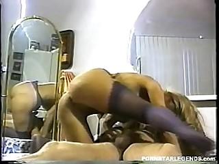 Huge boobs clasic porn star riding a cock