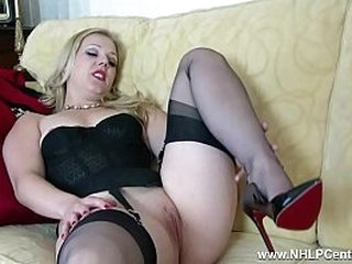 Hot blonde strip tease in vintage outfit